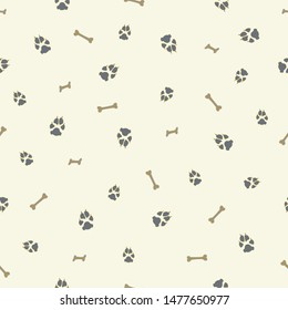 Colorful dog footprint and bone vector seamless pattern. Cool paw bone seamless template, isolated on contrast color backdrop.