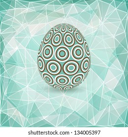 Colorful Easter egg on abstract geometric background with triangle polygons.