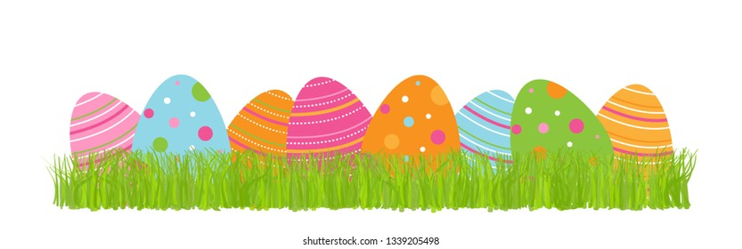 Colorful Easter eggs lying in green grass