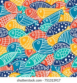 Colorful fish. Seamless pattern with cute ornamental fish. Sea background.