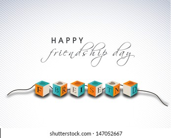 Colorful friendship band on abstract grey background for happy friendship day.