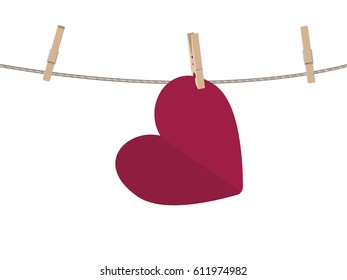 Colorful heart on a rope with wooden pegs.