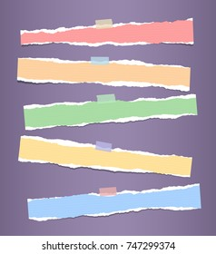 Colorful horizontal ripped strips, notebook, note paper for text or message stuck with sticky tape on purple background.
