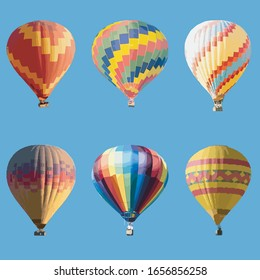 Colorful hot air balloon isolated on Blu background.