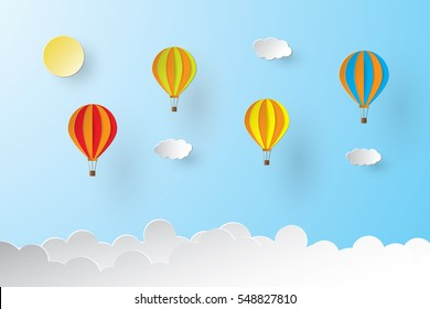 Colorful hot air balloon and sun over the cloud. paper art style.