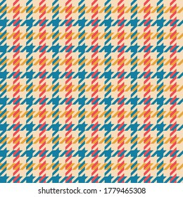 Colorful hounds tooth pattern vector in blue, red, yellow, beige. Seamless multicolored dog tooth check plaid for jacket, coat, skirt, or other modern spring and autumn textile print.