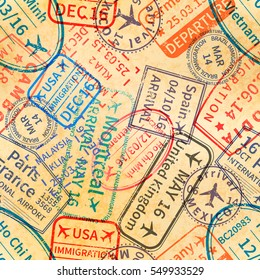 A lot of colorful International travel visa rubber stamps imprints on old paper, seamless pattern