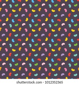 Colorful jelly beans candies seamless pattern on dark background.