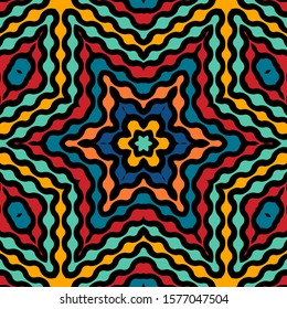 Colorful kaleidoscope seamless pattern design on dark background - floral or star shape ethnic style repeat pattern
