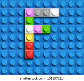 Colorful letters F of alphabet from building lego bricks on blue lego brick background. blue lego background. 3d letters F. Realistic letters