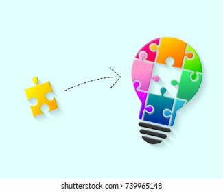 Colorful light bulb with puzzle piece as idea and solution concept
