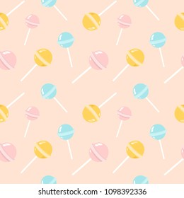 Colorful lollipops on pastel background in flat style design. Seamless background with cute candy.