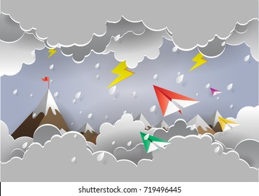 colorful origami airplane in the air with raining. paper art style