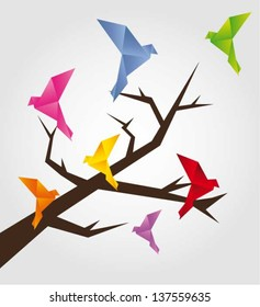 Colorful origami birds on tree