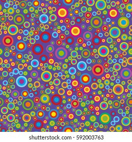 Colorful psychedelic circles on a violet background. Vector seamless pattern.