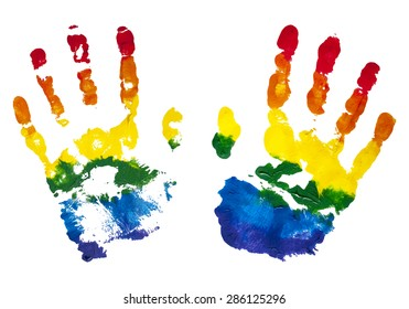 Colorful rainbow children hand prints painted with gouache for the expression of friendship isolated on white.