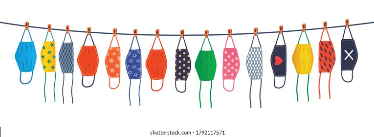 The colorful reusable masks are hanging on a line. Drying reusable masks.