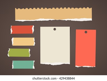 Colorful ripped blank note paper are stuck on dark brown background.