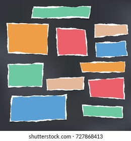 Colorful ripped striped note, copybook, notebook paper stuck on black background.