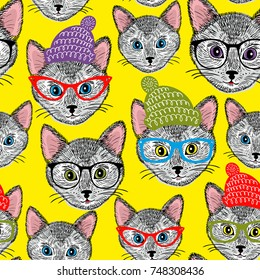 Colorful seamless pattern with cats in hats and glasses. Vector background.
