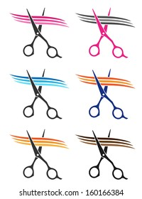 colorful set of scissors cuttig hair strand on white background