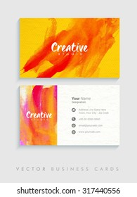 Colorful splash decorated, creative horizontal business card, name card or visiting card set on grey background.