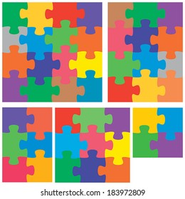 A colorful variety of flat jigsaw puzzles.