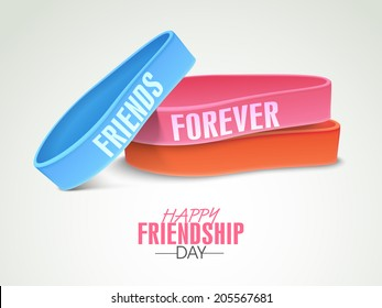Colorful wristbands with text Friends Forever on grey background on occasion of Happy Friendship Day celebrations.