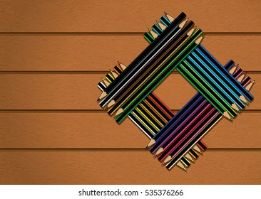 Colour Pencils Stacked in Square on Wood Texture Background