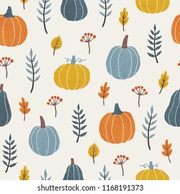 Colourful pumpkins, leafs and branches. Seasonal autumn seamless pattern. Vector illustration