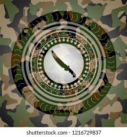 combat knife icon inside camo emblem