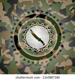 combat knife icon inside camouflage texture