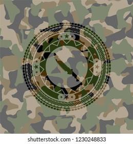 combat knife icon inside camouflage emblem