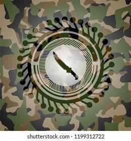 combat knife icon inside camouflaged emblem