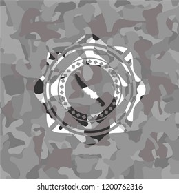 combat knife icon inside grey camouflage texture