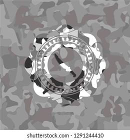 combat knife icon inside grey camo emblem