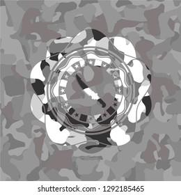 combat knife icon on grey camo texture