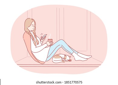Comfortable relaxing at home with smartphone and hot drink. Young happy girl cartoon character sitting on windowsill with tea, chatting online on smartphone, enjoying rest at home near sleeping cat - Shutterstock ID 1851770575