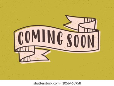 Coming Soon Lettering Or Inscription Written With Modern Font On Elegant Ribbon Tape Isolated