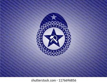 communism icon inside badge with denim texture