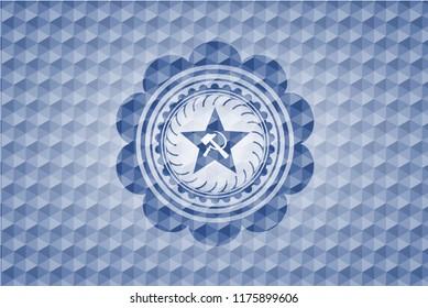 communism icon inside blue badge with geometric background.