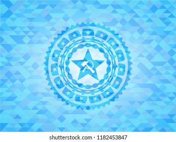 communism icon inside sky blue emblem with triangle mosaic background