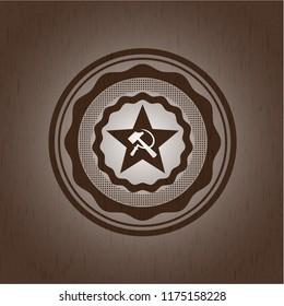 communism icon inside vintage wood emblem