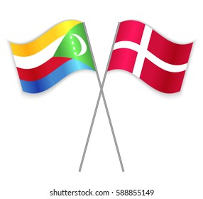 Comoran and Danish crossed flags. Comoros combined with Denmark isolated on white. Language learning, international business or travel concept.