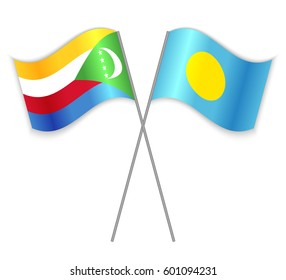 Comoran and Palauan crossed flags. Comoros combined with Palau isolated on white. Language learning, international business or travel concept.