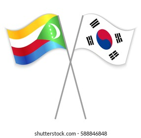 Comoran and South Korean crossed flags. Comoros combined with South Korea isolated on white. Language learning, international business or travel concept.