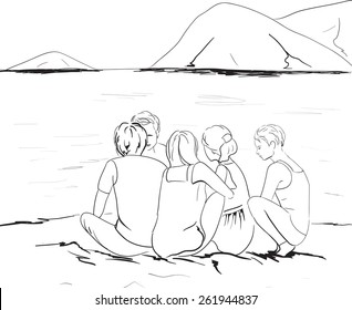 company is sitting on the beach with mountains in background