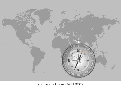compass on a world map, indicating the direction