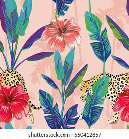 Composition of the tropical green banana leaves, red hibiscus flower, wild animal leopard, pink palm background. Seamless wallpaper pattern