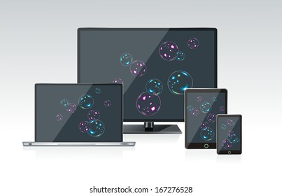 Computer monitor, laptop and tablet pc with a bubbles background